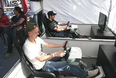 Был целый павильончик где можно было на халяву поиграться в гонки NFS с рулём и педалями. Правда, сети не было :-( А это большой минус.